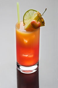 Mai Tai cocktail on a grey background with reflection